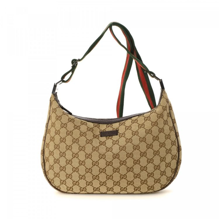 ea884cd76c6211 LXRandCo guarantees this is an authentic vintage Gucci Web Crossbody Bag  messenger & crossbody bag. This chic saddle bag was crafted in gg canvas in  beige.