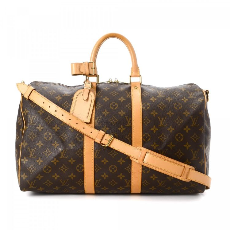 LXRandCo guarantees this is an authentic vintage Louis Vuitton Keepall 45  Bandouliere travel bag. Crafted in monogram coated canvas 42b54e92c737d