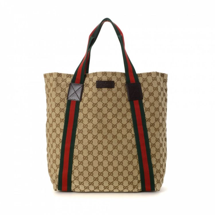 0c22fd25ec3 LXRandCo guarantees this is an authentic vintage Gucci Classic Web tote.  This practical bag in beautiful beige is made in gg canvas.