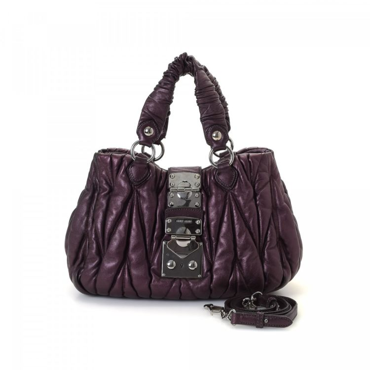 The authenticity of this vintage Miu Miu Coffer Two Way handbag is  guaranteed by LXRandCo. This exquisite handbag comes in burgundy leather. db3d4d99ea746
