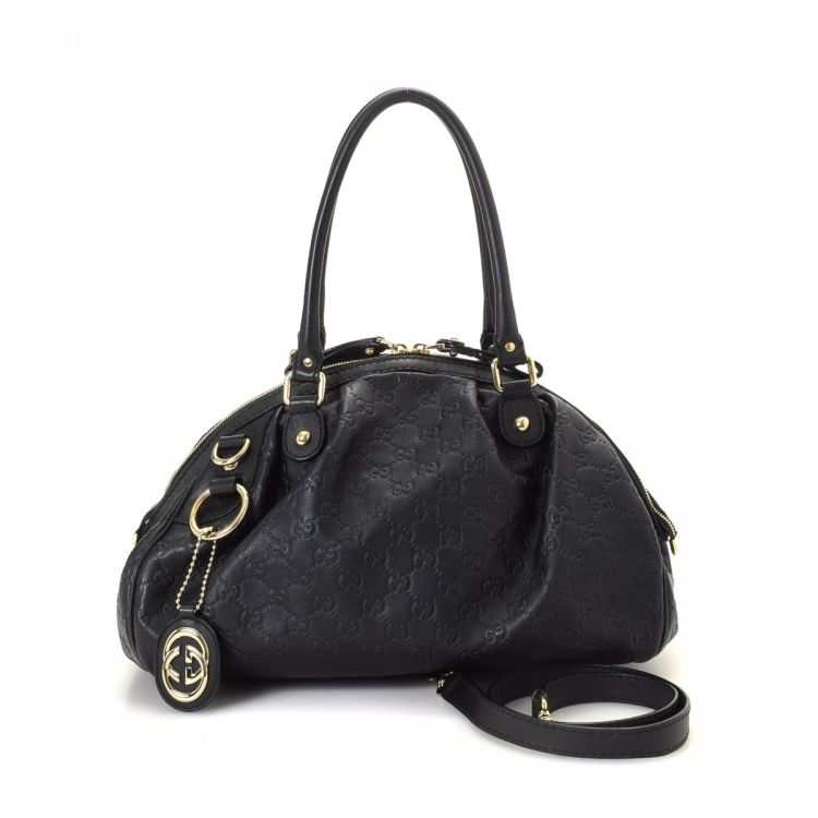 53326e270102 LXRandCo guarantees the authenticity of this vintage Gucci Sukey Two Way Bag  handbag. Crafted in guccissima leather, this luxurious purse comes in black.