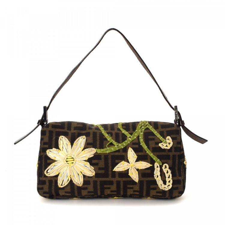 3ccc0517a810 LXRandCo guarantees this is an authentic vintage Fendi Floral Baguette  shoulder bag. This stylish pocketbook was crafted in zucca canvas in brown.