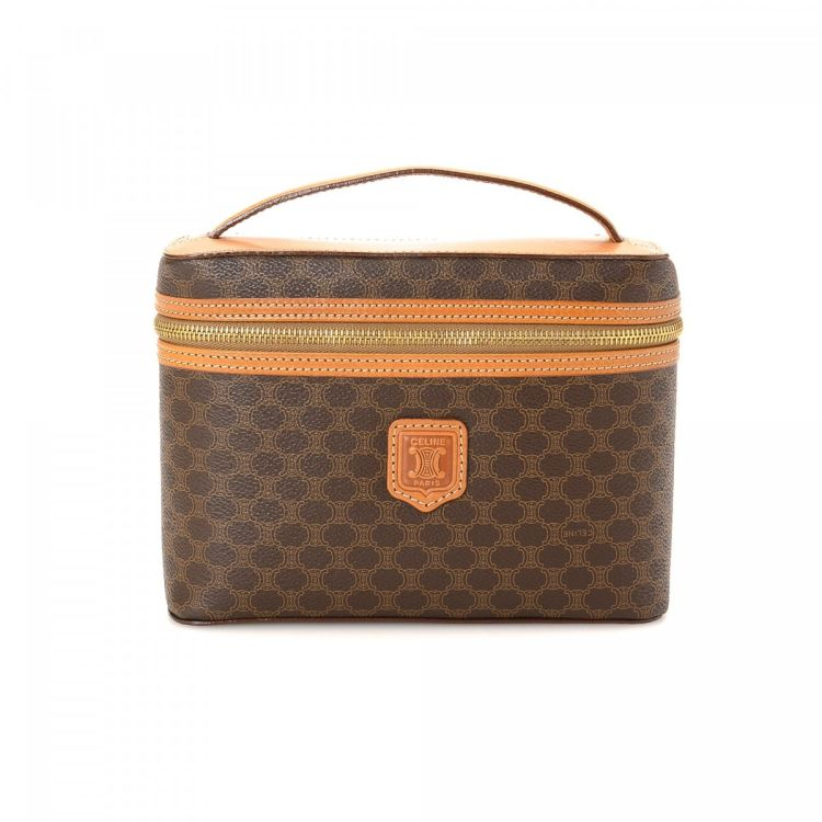 8c3257856861 LXRandCo guarantees the authenticity of this vintage Céline Vanity Case  vanity case   pouch. This stylish makeup case was crafted in macadam coated  canvas ...
