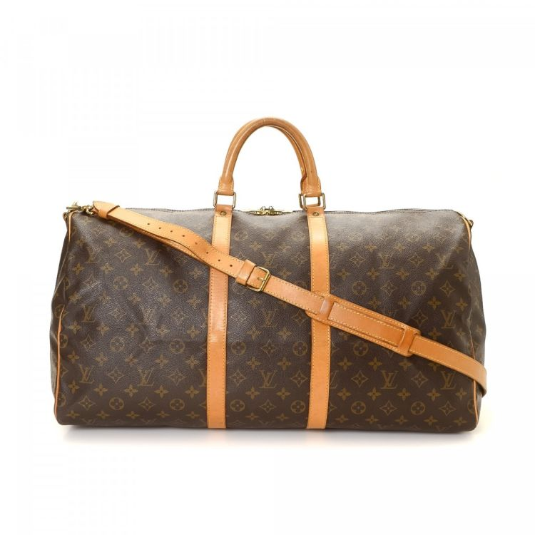 3e2ead8e3f56 LXRandCo guarantees this is an authentic vintage Louis Vuitton Keepall 55  Bandouliere travel bag. Crafted in monogram coated canvas