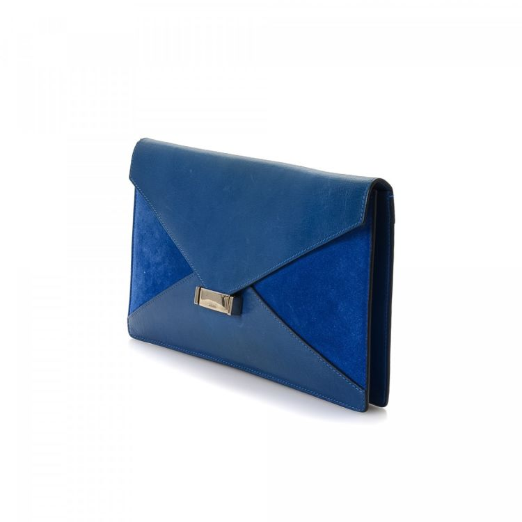 a5b717e899d LXRandCo guarantees this is an authentic vintage Céline Envelope clutch.  This iconic evening bag in beautiful blue is made of leather and suede.