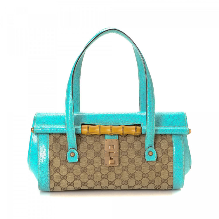 7d66b1b490825 LXRandCo guarantees this is an authentic vintage Gucci Bamboo Bullet Bag  handbag. This exquisite purse in beautiful two-tone is made in gg canvas.