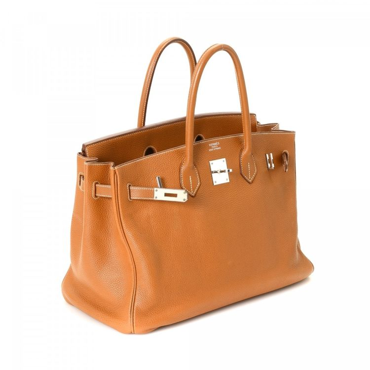 89e377f1b2b LXRandCo guarantees the authenticity of this vintage Hermès birkin 35 Gold  PHW handbag. This iconic handbag was crafted in togo calf in hermes gold.