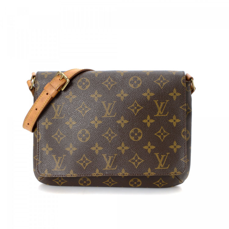 8ed268ba92d2 LXRandCo guarantees this is an authentic vintage Louis Vuitton Musette  Tango Short Strap shoulder bag. Crafted in monogram coated canvas