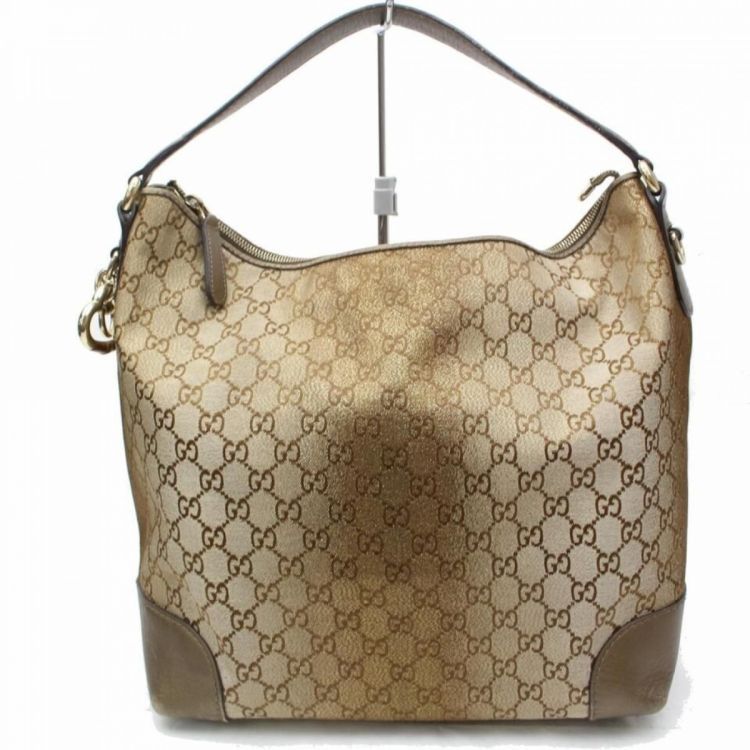 142a773e4ff LXRandCo guarantees the authenticity of this vintage Gucci Glitter Hobo  shoulder bag. This exquisite shoulder bag in beautiful brown is made in  guccissima ...