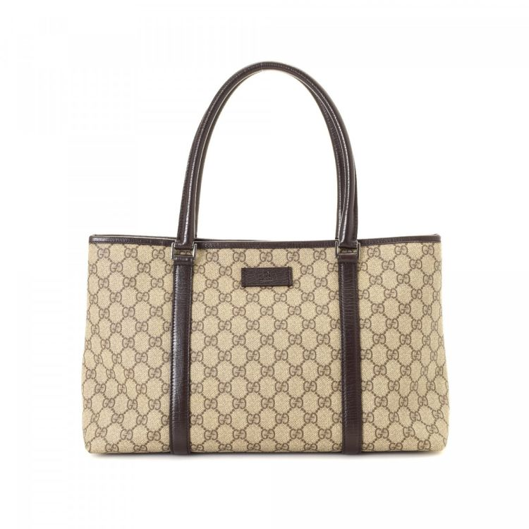 c2d4f8258766 LXRandCo guarantees this is an authentic vintage Gucci Canvas tote. This  everyday work bag in beautiful beige is made in gg supreme coated canvas.