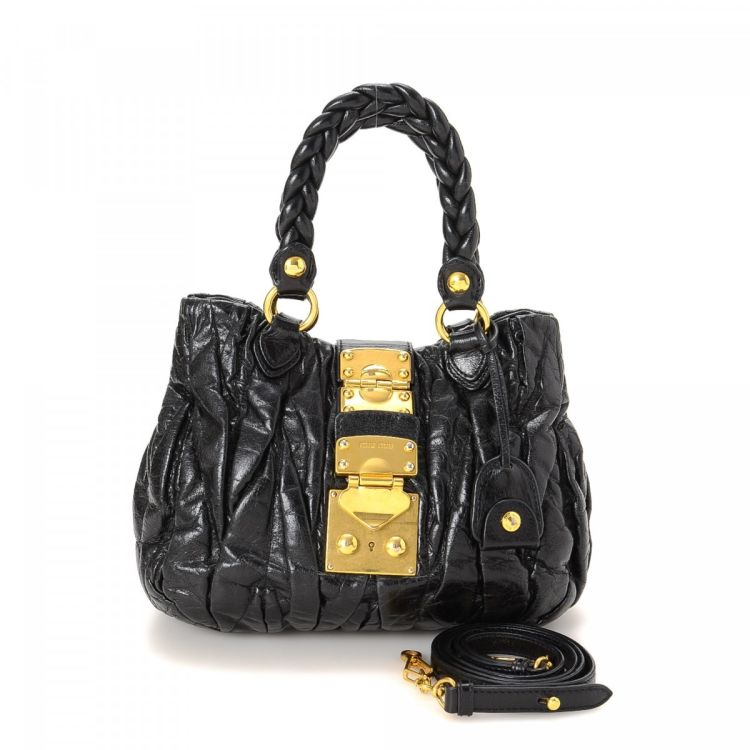 9faabcee8012 LXRandCo guarantees the authenticity of this vintage Miu Miu Coffer  shoulder bag. Crafted in matelassé leather