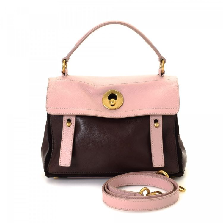 ff51e40aee5 LXRandCo guarantees this is an authentic vintage Yves Saint Laurent Muse  Two handbag. This iconic handbag in beautiful two-tone is made of leather.