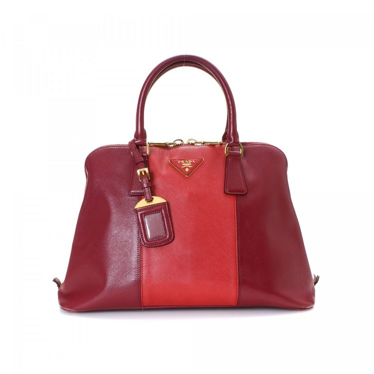 ... get lxrandco guarantees this is an authentic vintage prada handbag.  crafted in saffiano leather this 79d6918d12ac4