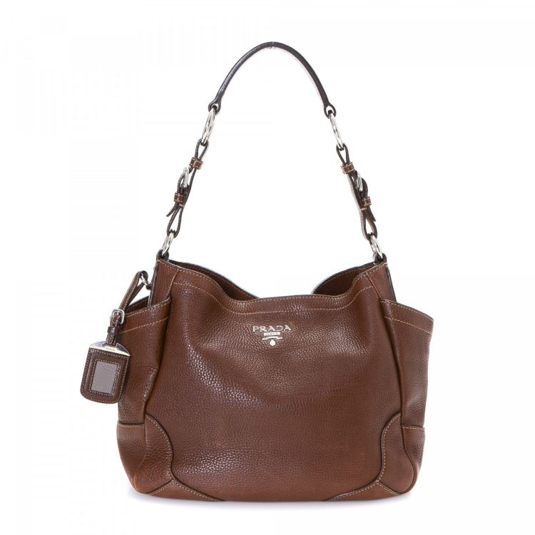 33283f642959 LXRandCo guarantees the authenticity of this vintage Prada shoulder bag.  This luxurious shoulder bag in beautiful brown is made in vitello daino  leather.