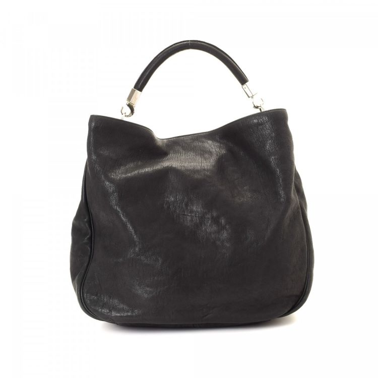 059ee9666d12 LXRandCo guarantees the authenticity of this vintage Yves Saint Laurent  Roady Hobo shoulder bag. Crafted in leather