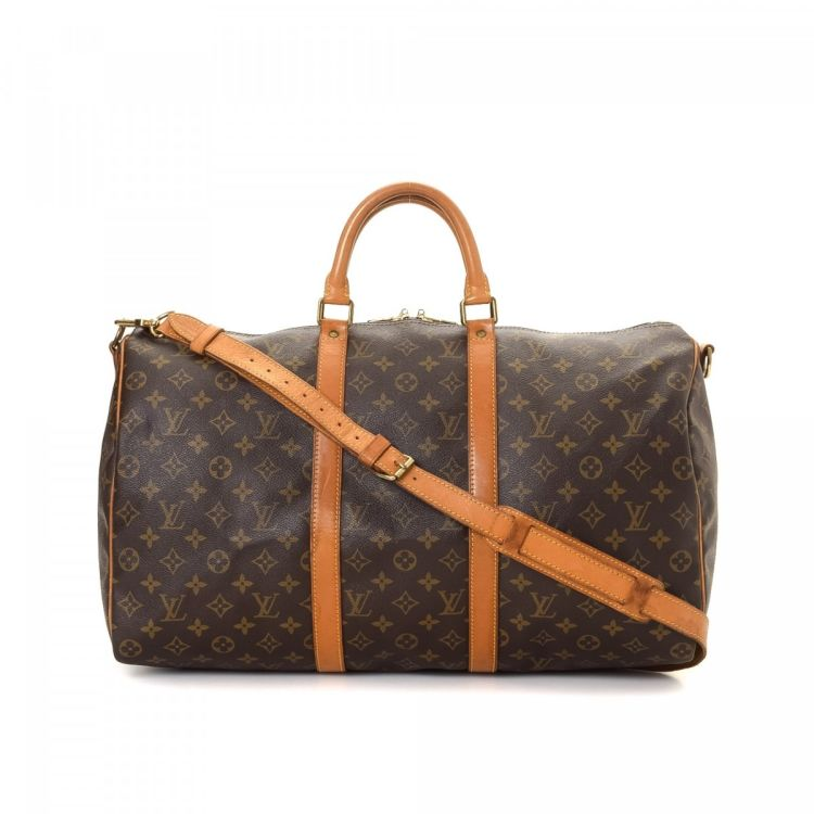 c9ed2385348e LXRandCo guarantees this is an authentic vintage Louis Vuitton Keepall 50  travel bag. This chic boston bag in brown is made in monogram coated canvas.