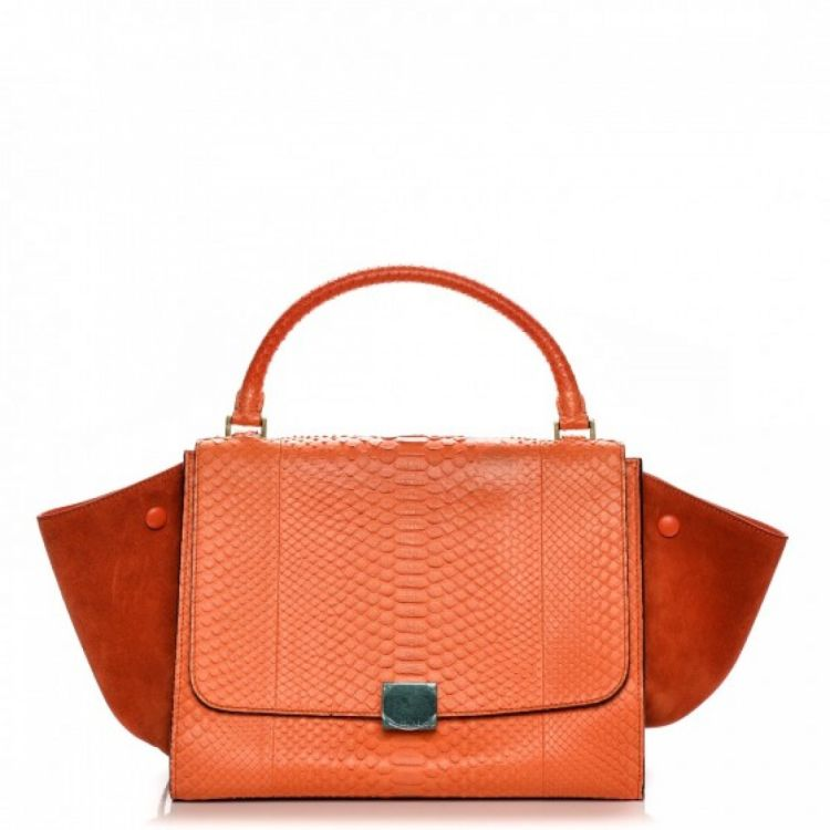 a37c55f489 LXRandCo guarantees this is an authentic vintage Céline Python Suede Medium  Trapeze handbag. This classic pocketbook comes in orange snakeskin.