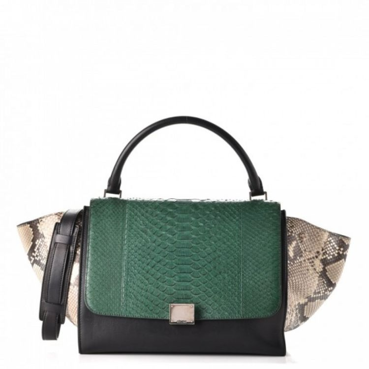 3492777db2 The authenticity of this vintage Céline Calfskin Tricolor Medium Trapeze  handbag is guaranteed by LXRandCo. This luxurious bag comes in multi color  python.
