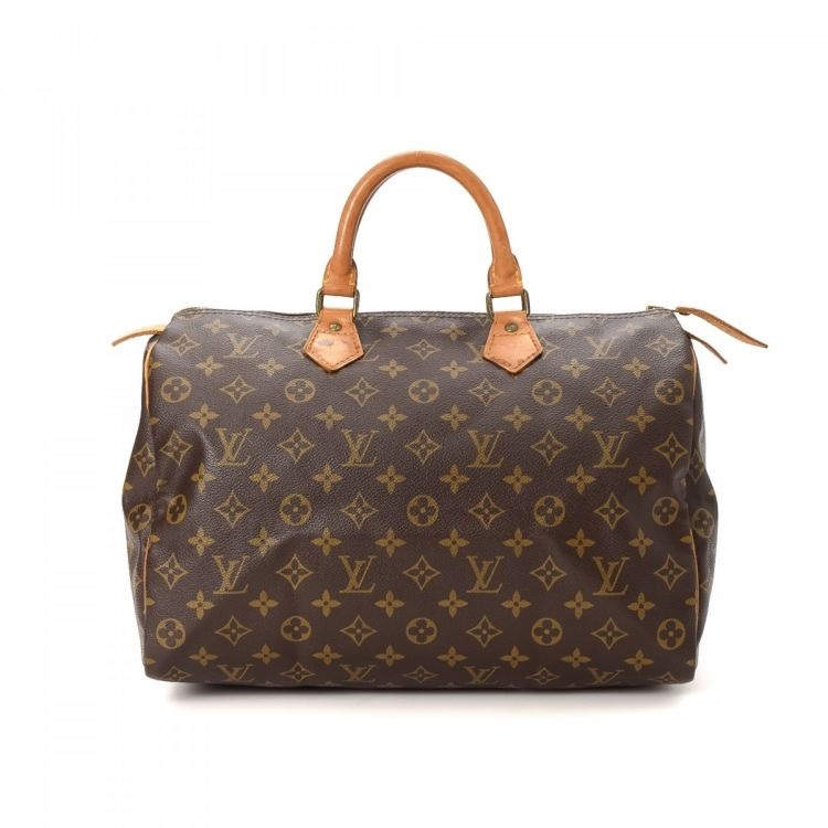 d819673a0b71 LXRandCo guarantees the authenticity of this vintage Louis Vuitton Speedy 35  handbag. This sophisticated purse in beautiful brown is made in monogram  coated ...