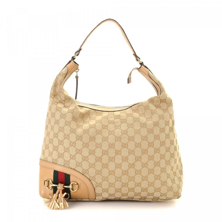 84005c95e LXRandCo guarantees the authenticity of this vintage Gucci Horsebit Tassel  Medium Hobo Bag shoulder bag. This refined bag in beige is made in gg canvas .