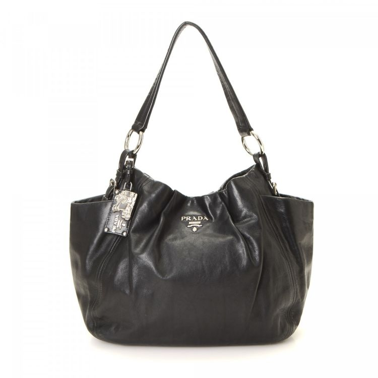 b0e78ae3884c LXRandCo guarantees the authenticity of this vintage Prada shoulder bag.  This everyday shoulder bag was crafted in cervo shine deerskin in black.