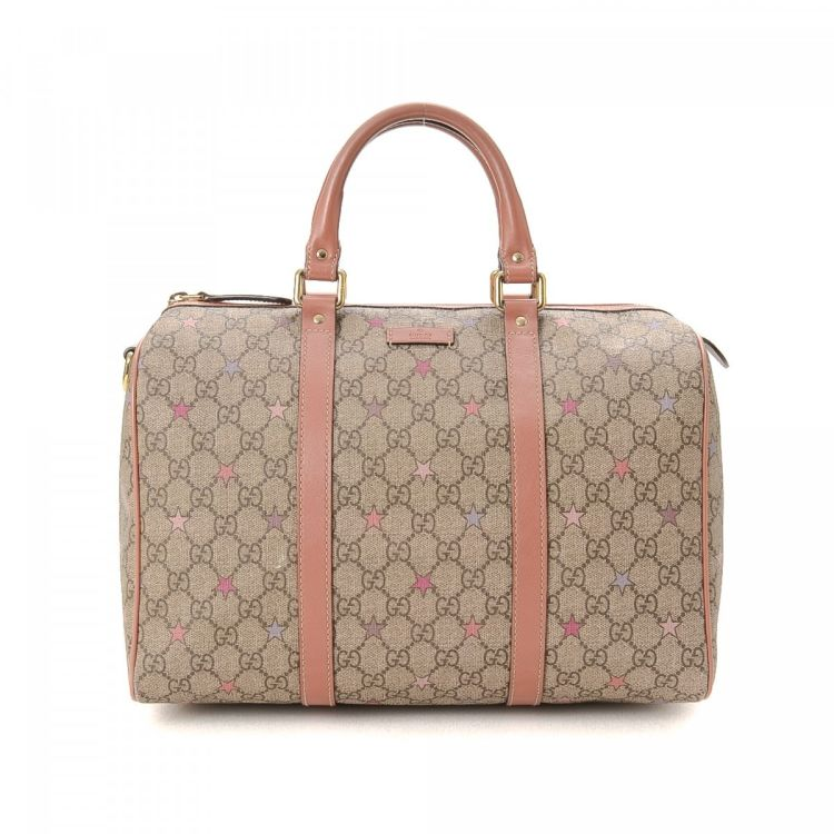 c63216ce130 LXRandCo guarantees the authenticity of this vintage Gucci Handbag travel  bag. Crafted in gg supreme stars coated canvas