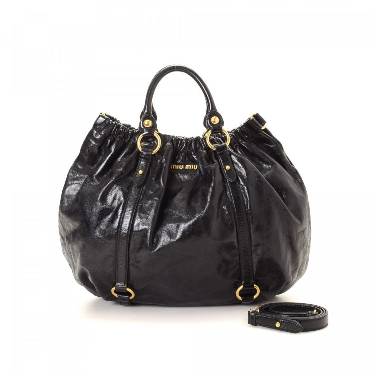 25ffa1e43e7 LXRandCo guarantees this is an authentic vintage Miu Miu VVitello Two Way  handbag. This signature pocketbook in black is made in vitello lux patent  leather.