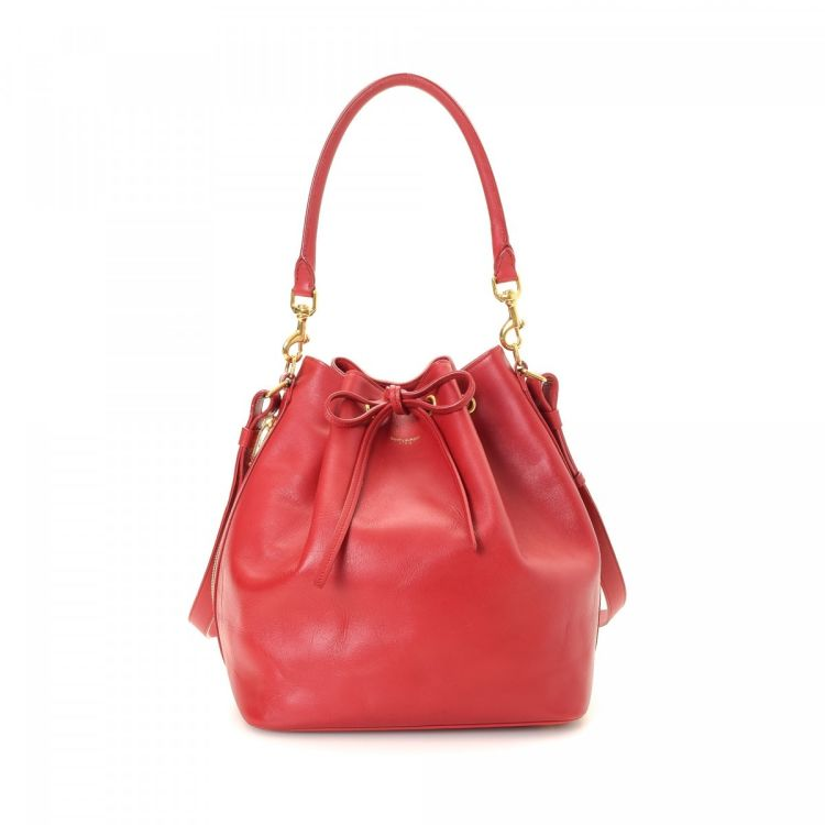087befb72479 LXRandCo guarantees this is an authentic vintage Yves Saint Laurent  Emmanuelle Bucket handbag. This practical purse was crafted in calf in  beautiful red.