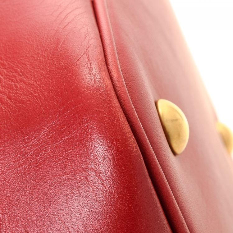10e7fcaf6a4db LXRandCo guarantees this is an authentic vintage Yves Saint Laurent  Emmanuelle Bucket handbag. This practical purse was crafted in calf in  beautiful red.