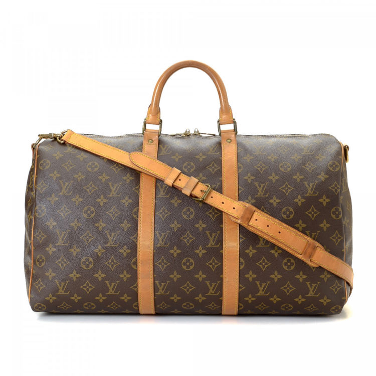 49591c44b9f0 LXRandCo guarantees the authenticity of this vintage Louis Vuitton Keepall  50 Bandoulière travel bag. Crafted in monogram coated canvas