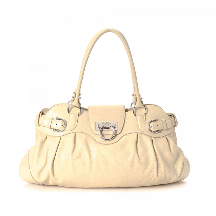 e07fc09781d0 The authenticity of this vintage Ferragamo Marisa shoulder bag is guaranteed  by LXRandCo. Crafted in gancini leather
