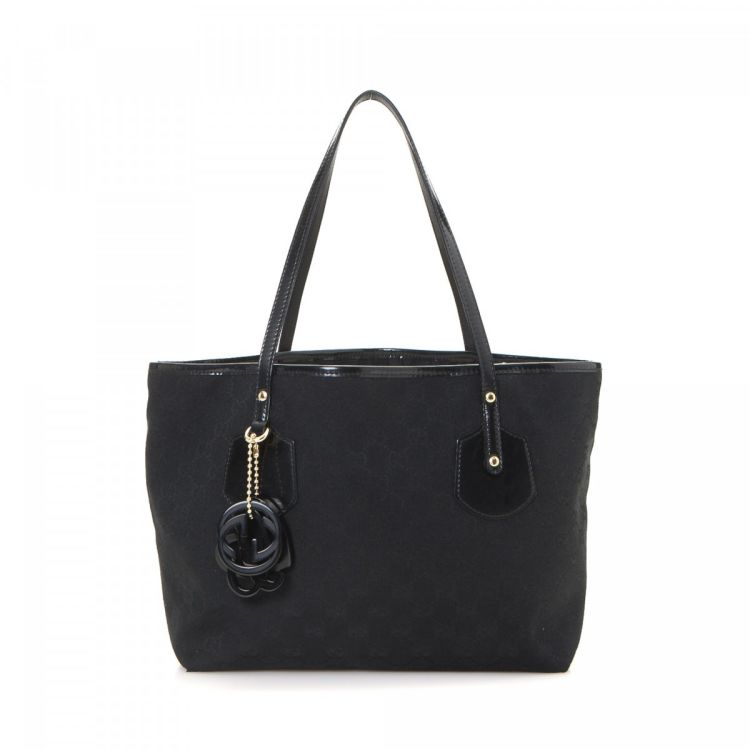 efd3af729656 LXRandCo guarantees this is an authentic vintage Gucci Jolie Small tote.  This classic bag in beautiful black is made in gg canvas. Due to the  vintage nature ...
