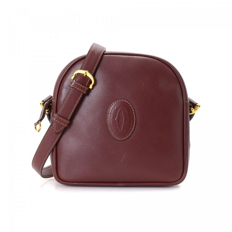 828bdb57ff LXRandCo guarantees this is an authentic vintage Cartier shoulder bag. This  elegant pocketbook in bordeaux is made of leather. Due to the vintage  nature of ...