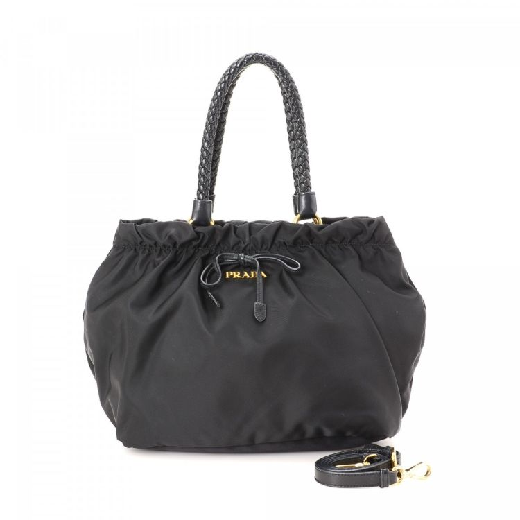 90d235c0406a LXRandCo guarantees this is an authentic vintage Prada Two Way Bag handbag.  This stylish purse in black is made in tessuto nylon. Due to the vintage  nature ...