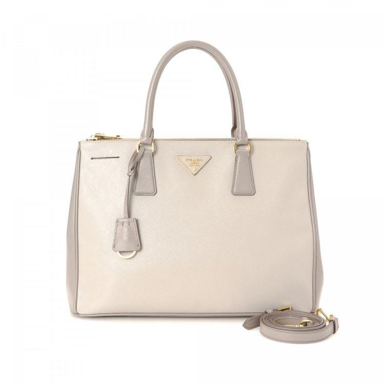 ac4384d341e6 LXRandCo guarantees the authenticity of this vintage Prada Galleria handbag.  This classic bag was crafted in saffiano leather in two-tone.