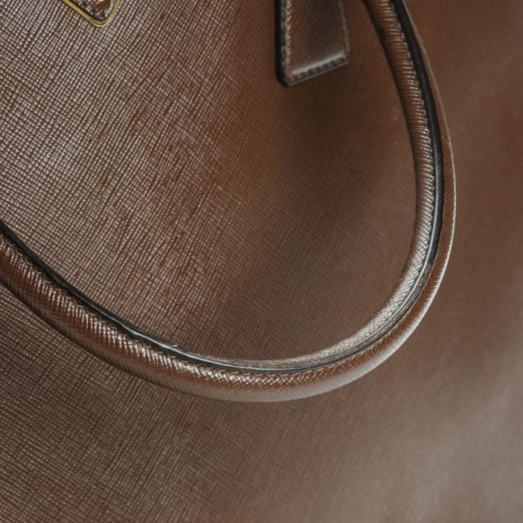 2cc8c5fa68ee ... sweden the authenticity of this vintage prada extra large galleria  double zip tote is guaranteed by