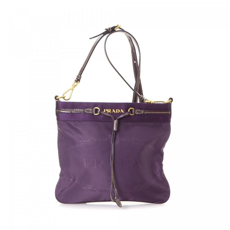 ac3faf8b93f7 LXRandCo guarantees this is an authentic vintage Prada Jacquard shoulder bag.  This refined purse in violet is made in canapa canvas.