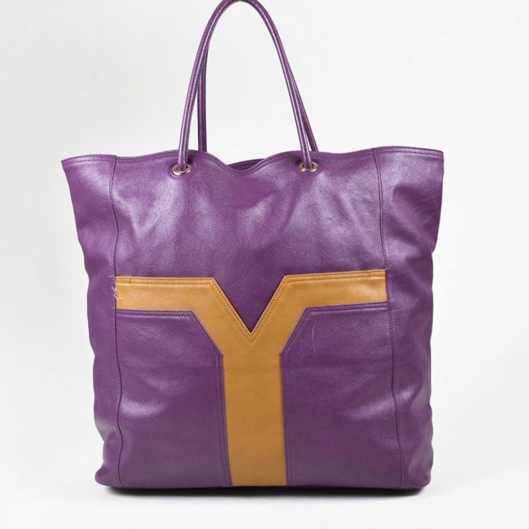 d3a09e0372 The authenticity of this vintage Yves Saint Laurent Lucky Chyc Bag tote is  guaranteed by LXRandCo. This elegant large handbag comes in purple leather.