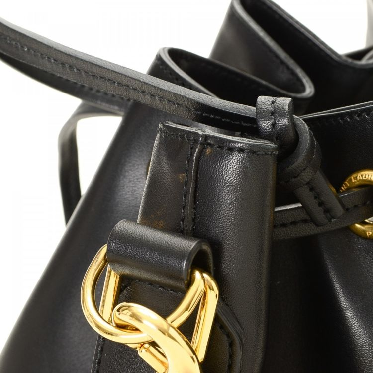 ae603b13495d7 LXRandCo guarantees the authenticity of this vintage Yves Saint Laurent  Emmanuelle Bucket Bag shoulder bag. This lovely shoulder bag in black is made  of ...