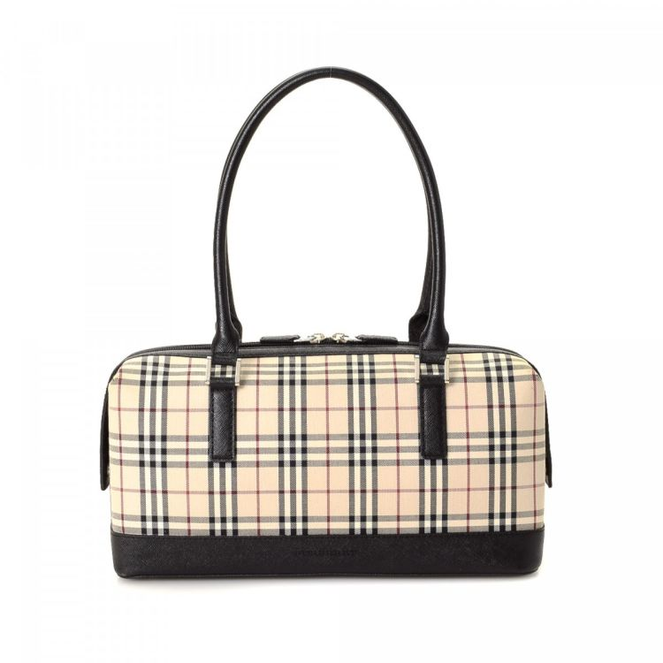 8b111f01bff2 LXRandCo guarantees the authenticity of this vintage Burberry shoulder bag.  Crafted in canvas