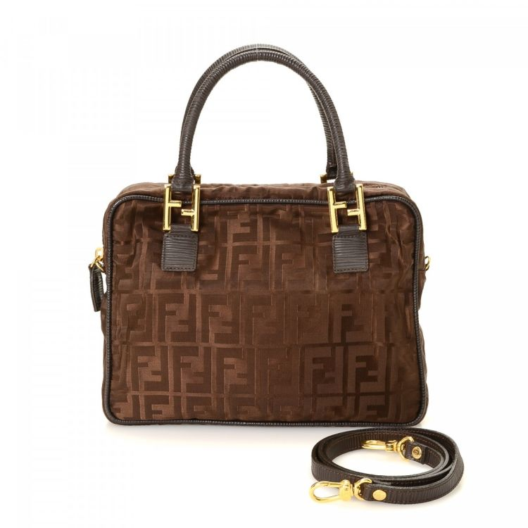 48fcae9a9eda LXRandCo guarantees this is an authentic vintage Fendi handbag. Crafted in zucca  canvas