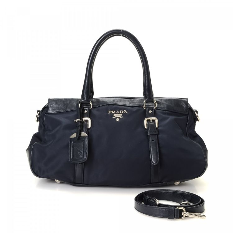 0a686f82cc12 LXRandCo guarantees this is an authentic vintage Prada Two Way Bag tote.  This beautiful work bag was crafted in tessuto nylon in dark blue.