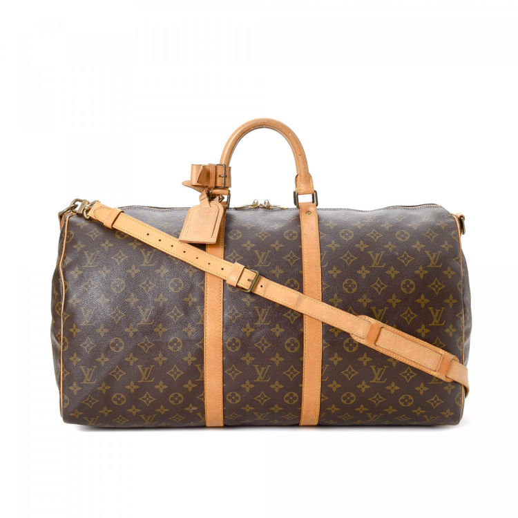 d086830f45b0 LXRandCo guarantees this is an authentic vintage Louis Vuitton Keepall 55  Bandoulière travel bag. This classic carry on was crafted in monogram coated  ...