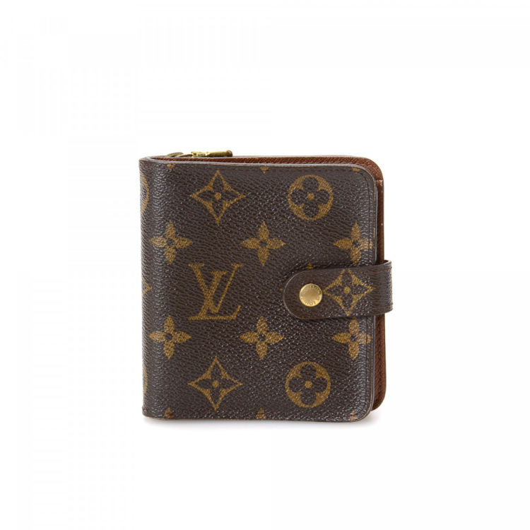 87a78962fe75 The authenticity of this vintage Louis Vuitton Elise wallet is guaranteed  by LXRandCo. This luxurious card holder was crafted in monogram coated  canvas in ...