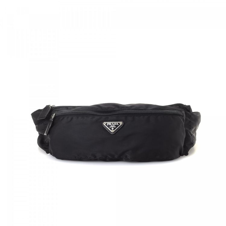 214ea9bc4154 The authenticity of this vintage Prada Waist Pouch vanity case & pouch is  guaranteed by LXRandCo. Crafted in tessuto nylon, this elegant pouch comes  in ...