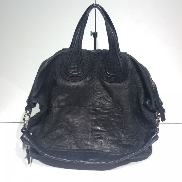 LXRandCo guarantees this is an authentic vintage Givenchy Nightingale tote.  This classic work bag in beautiful black is made of leather. cc5b547364dce