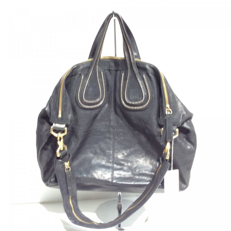 LXRandCo guarantees the authenticity of this vintage Givenchy Studded  Nightingale Medium shoulder bag. This stylish shoulder bag was crafted in  leather in ... a9e8b63801f10