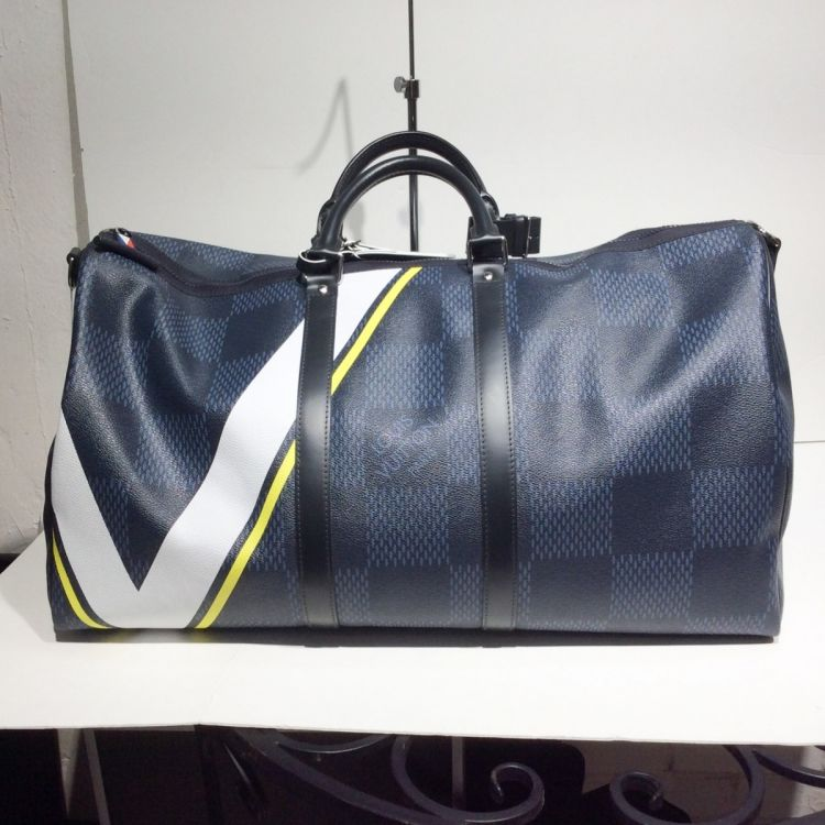 7b4dc285996a5 The authenticity of this vintage Louis Vuitton America s Cup Keepall 55  Bandoulière travel bag is guaranteed by LXRandCo. Crafted in damier cobalt  lv cup ...