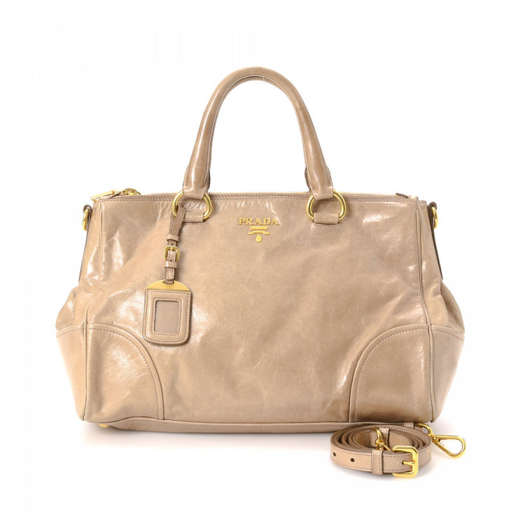 eaae0d4beb23 LXRandCo guarantees this is an authentic vintage Prada Two Way Bag handbag.  Crafted in vitello lux leather, this everyday handbag comes in beige.