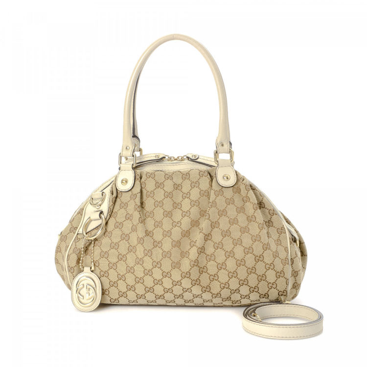 8c886a2a3aa4 LXRandCo guarantees the authenticity of this vintage Gucci Sukey tote.  Crafted in gg canvas, this classic bag comes in beautiful beige. Due to the  vintage ...